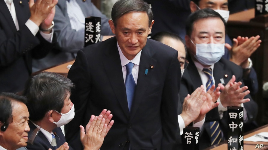 Yoshihide Suga is applauded after being elected as Japan's new prime minister at parliament's lower house in Tokyo, Wednesday,…