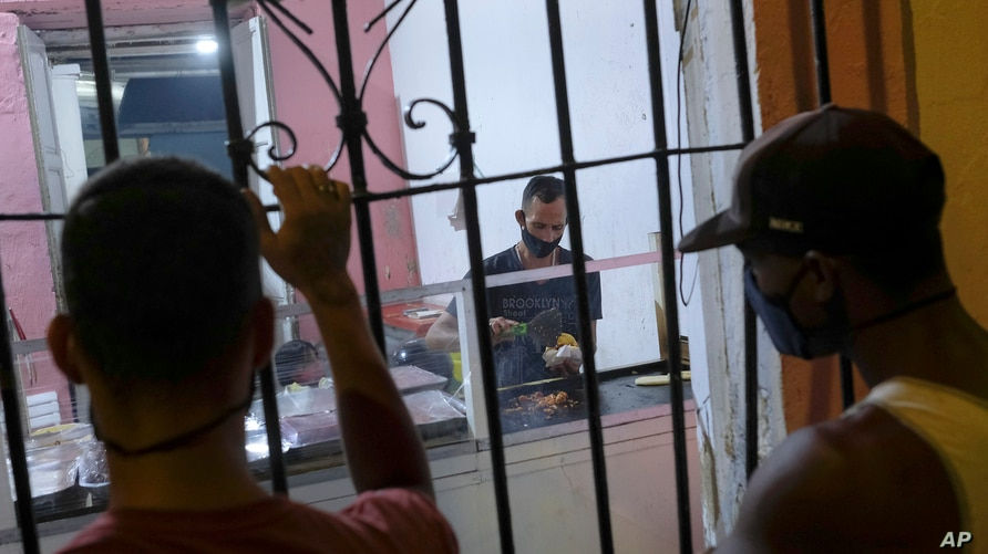 "Cook Jose Antonio Subero works making ""arepas"" from La Flaca food cart set up inside the home of the cart's owner Dioselis…"
