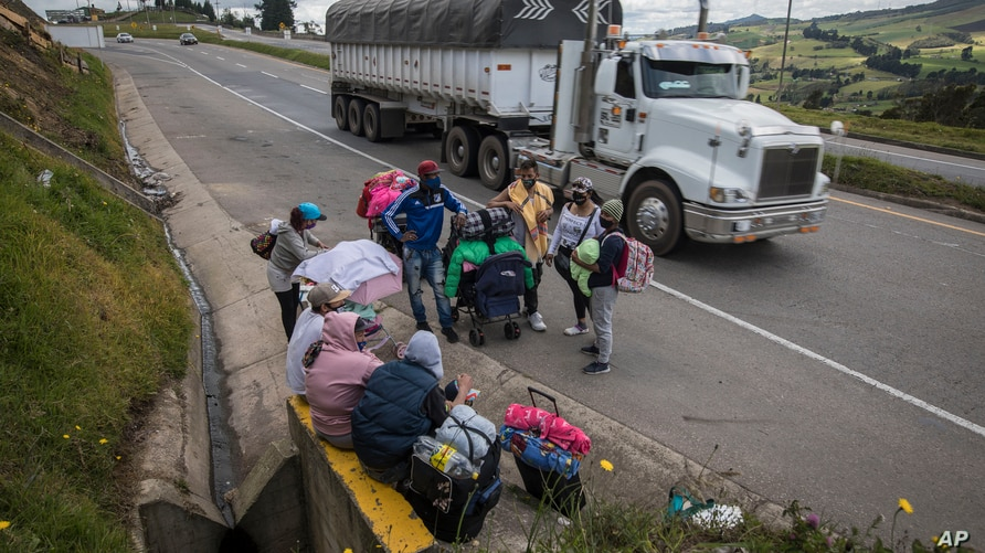 Venezuelan migrants take a rest as they walk towards Bogota, in Tunja, Colombia, Tuesday, Oct. 6, 2020. Thousands of…