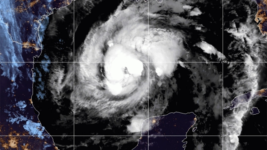 This satellite image provided by the National Oceanic and Atmospheric Administration shows Tropical Storm Zeta, Wednesday, Oct…