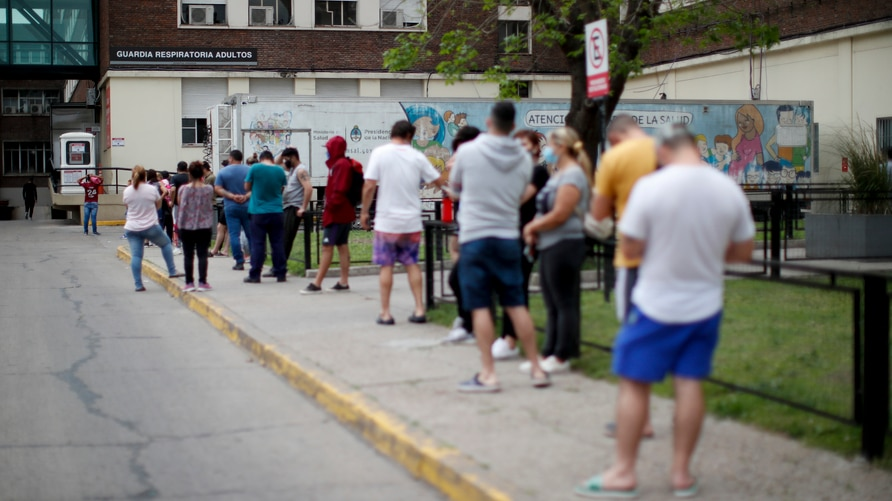People line up to get COVID-19 tests at a hospital in Buenos Aires, Argentina, Monday, Oct. 19, 2020. (AP Photo/Natacha…