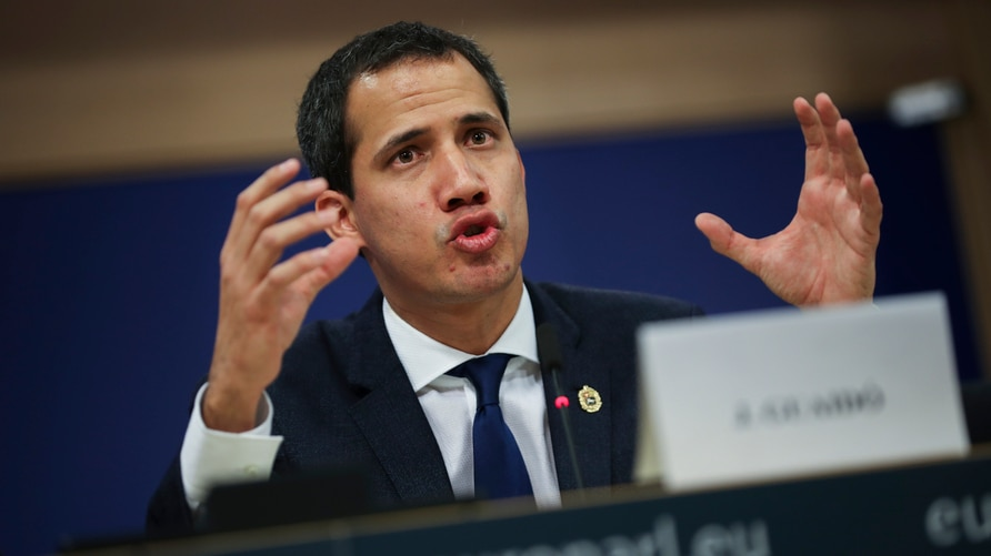 Leader of Venezuela's political opposition Juan Guaido talks to journalists during a joint press conference with European…