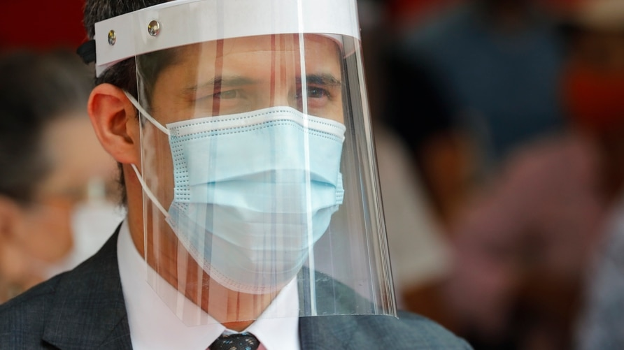 Opposition leader Juan Guaido attends an event by health workers to honor their colleagues who have died of COVID-19 in Caracas…