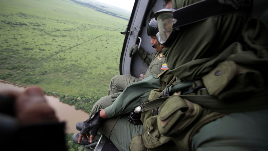 Soldiers flight over Venezuela's southern plains during an operation to destroy a clandestine airstrip used by drug traffickers…