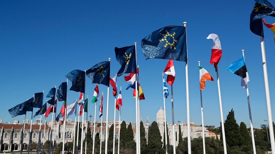 The flags of the European Union countries fly outside the Belem Cultural Center in Lisbon ahead of the meeting of the President…