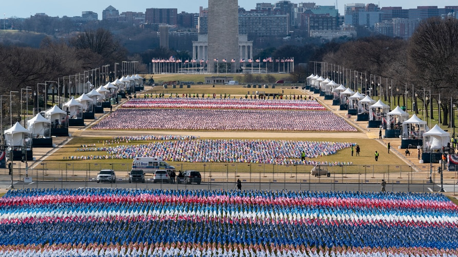 Flags are placed on the National Mall, looking towards the Washington Monument, and the Lincoln Memorial, ahead of the…
