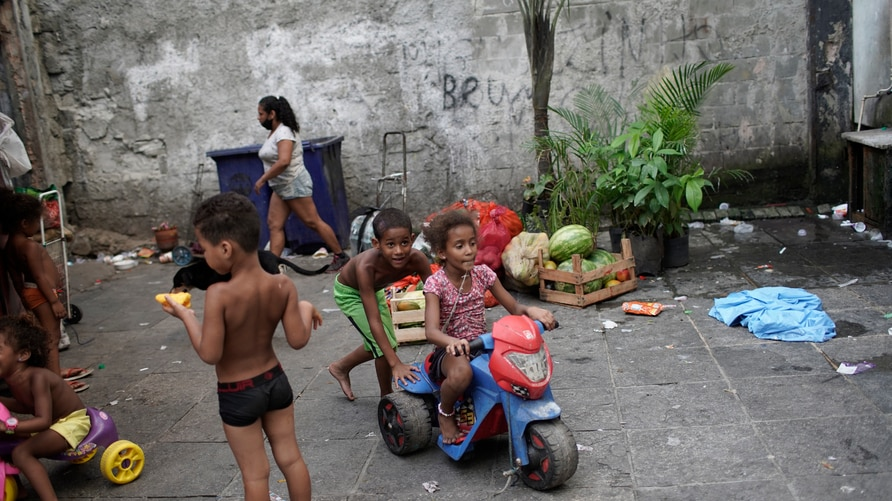 Children play in an occupied building that used to house a factory, amid the new coronavirus pandemic, in Rio de Janeiro,…