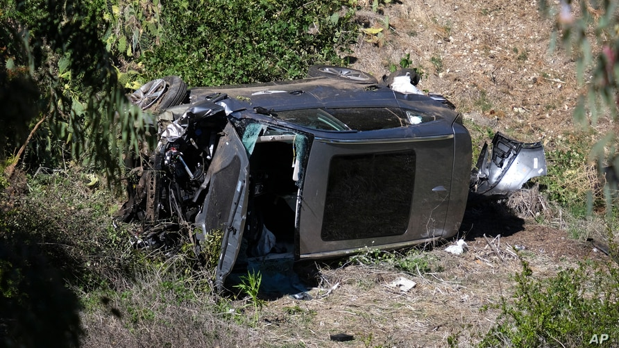 A vehicle rests on its side after a rollover accident involving golfer Tiger Woods along a road in the Rancho Palos Verdes…