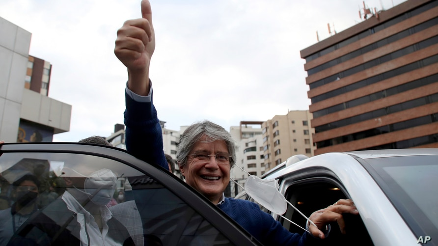 Presidential candidate Guillermo Lasso, representing the Creating Opportunities party or CREO, flashes a thumbs up after…