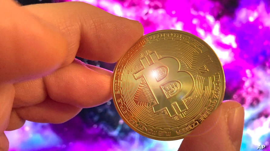 Photo by: STRF/STAR MAX/IPx 2021 2/16/21 Bitcoin breaks above 50K for the first time as major investors take interest in…