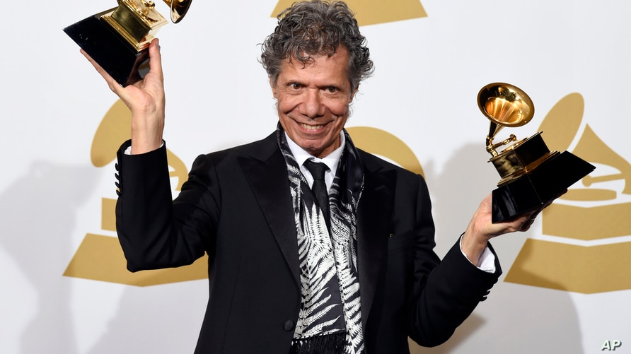 """FILE - Chick Corea poses in the press room with the awards for best improvised jazz solo for """"Fingerprints"""" and best jazz…"""