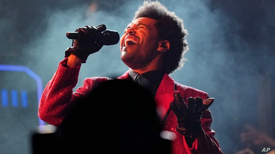 FILE - The Weeknd performs during the halftime show of the NFL Super Bowl 55 football game on Feb. 7, 2021, in Tampa, Fla.  The…
