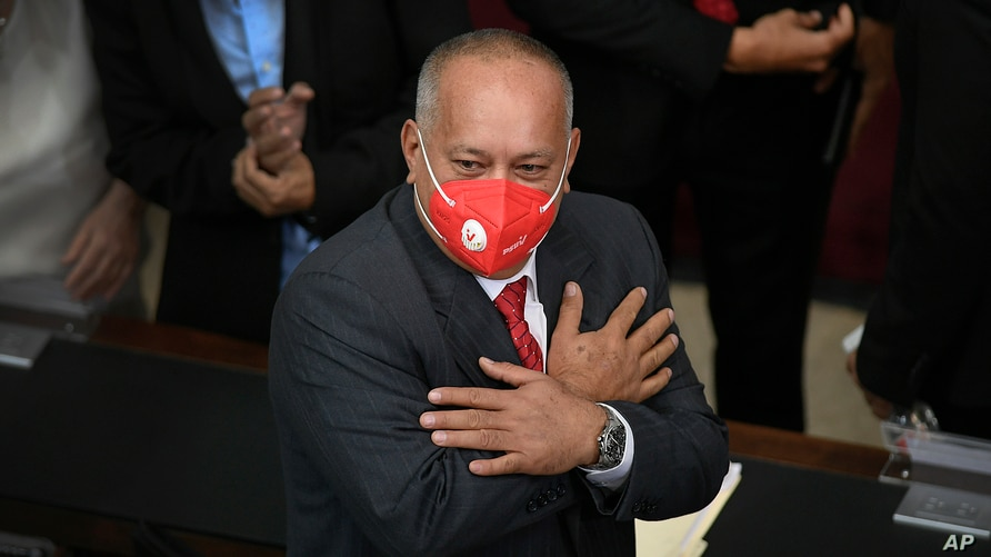 Socialist party leader Diosdado Cabello greets lawmakers as he arrives to the first legislative session of the new year, in…