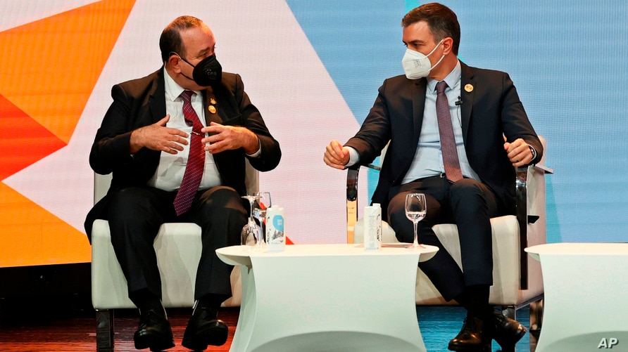 The president of Guatemala, Alejandro Giammattei, left and Spain's Prime Minister Pedro Sanchez take part in the Latin American…