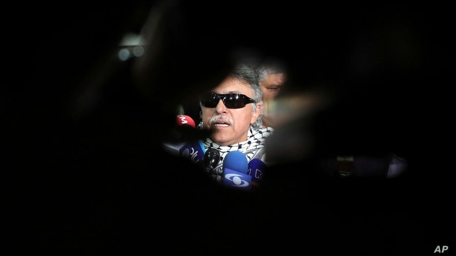 Former FARC rebel Jesus Santrich talks to the media after he attended a session of the Chamber of Representatives at the…