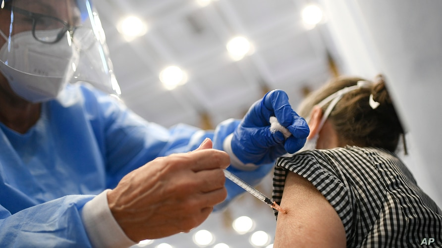 A doctor inoculates a woman with a dose of the Sputnik V COVID-19 vaccine during a vaccination campaign for seniors, at the…