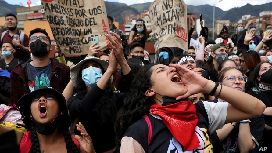 Women shout slogans during a demonstration against government-proposed tax reform, marking May Day, or International Workers'…