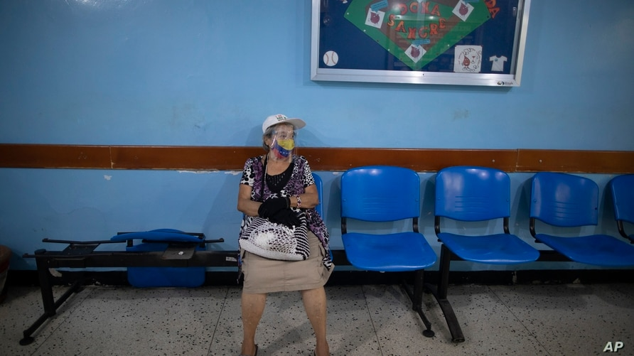 Juana Guerrero, 80, waits to be inoculated with a dose of the Sputnik V COVID-19 vaccine at the Perez Carreno public hospital…
