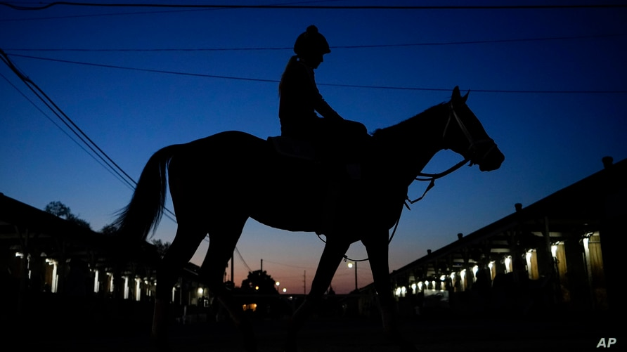 A jockey heads back to the barns at Churchill Downs Friday, April 30, 2021, in Louisville, Ky. The 147th running of the…
