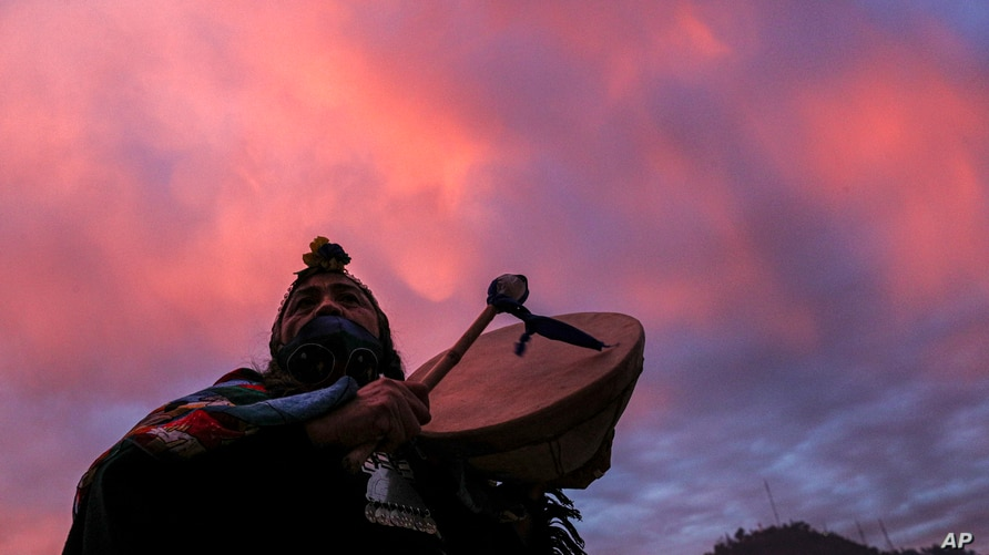 Indigenous Mapuche Constituent assembly candidate Juana Millal, for the Partido del Pueblo, plays a kultrun drum while…