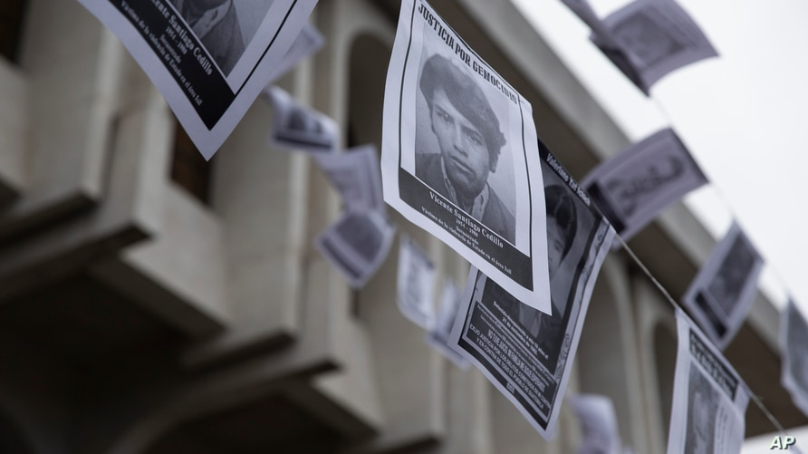 Photos of persons who were forcibly disappeared hang in front of the Supreme Court building during a genocide case hearing in…