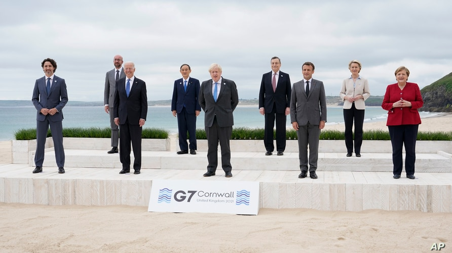 Leaders of the G7 pose for a group photo on overlooking the beach at the Carbis Bay Hotel in Carbis Bay, St. Ives, Cornwall,…