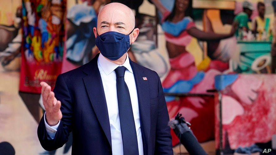 Secretary of Homeland Security Alejandro Mayorkas speaks with the media outside of the Little Haiti Cultural Center, Tuesday,…