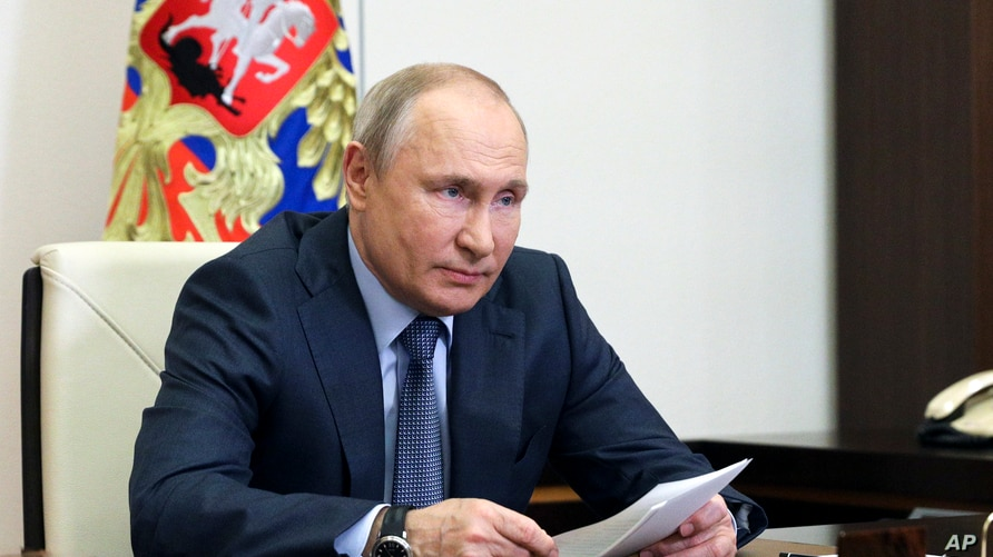 Russian President Vladimir Putin attends a meeting via video conference at the Novo-Ogaryovo residence outside Moscow, Russia,…