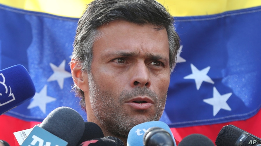 Venezuelan opposition leader Leopoldo Lopez speaks during a press conference at the gate of the Spanish ambassador's residence…