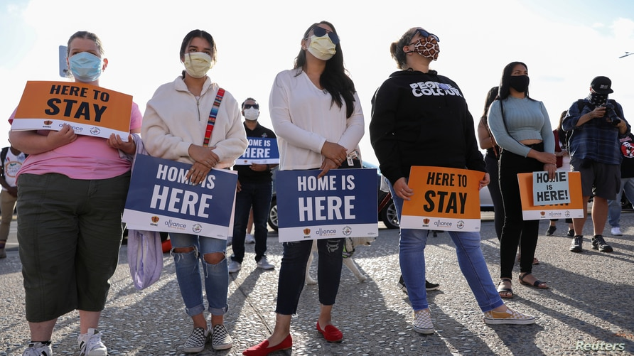 """Rally for """"Justice Everywhere"""" to celebrate the U.S. Supreme Court's ruling to disallow the rescinding of the DACA program, in San Diego"""