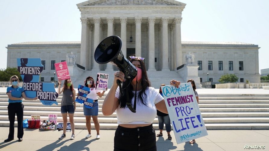 Pro-life demonstrators await a Supreme Court decision on a Louisiana abortion case in Washington