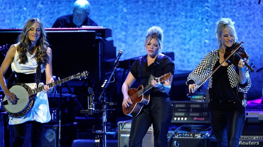 FILE PHOTO: Dixie Chicks, Emily Robison, Natalie Maines and Martie Maguire perform at the opening night of the Nokia Theatre L.A. Live in Los Angeles