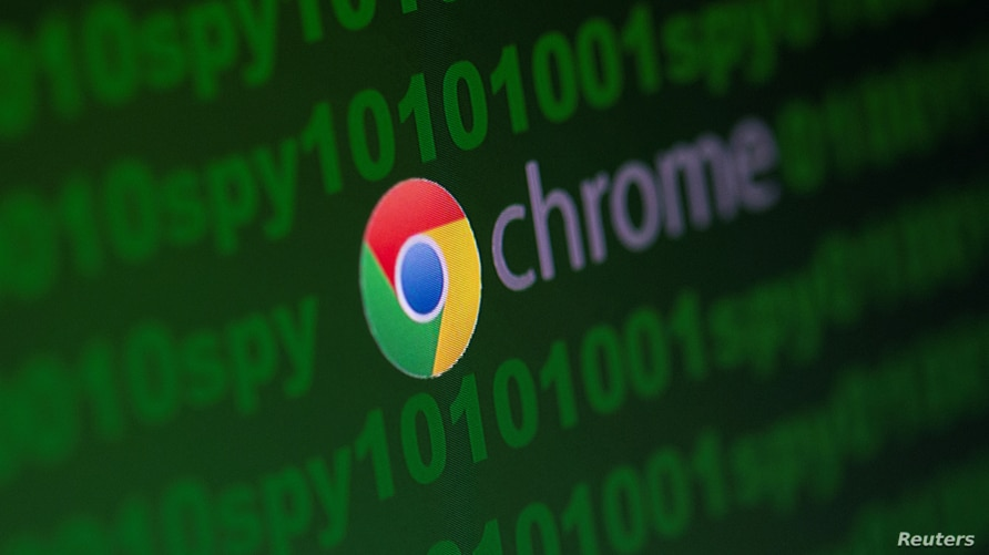 """Google Chrome logo is seen near cyber code and words """"spy""""  in this illustration picture"""
