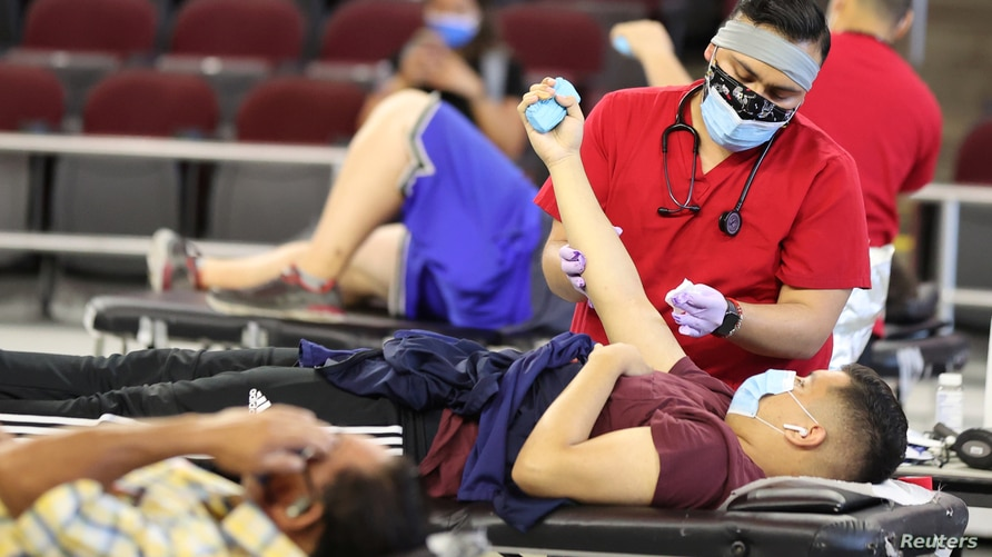 A man gives blood at a Red Cross blood drive, as the global outbreak of the coronavirus disease (COVID-19) continues, in Los Angeles