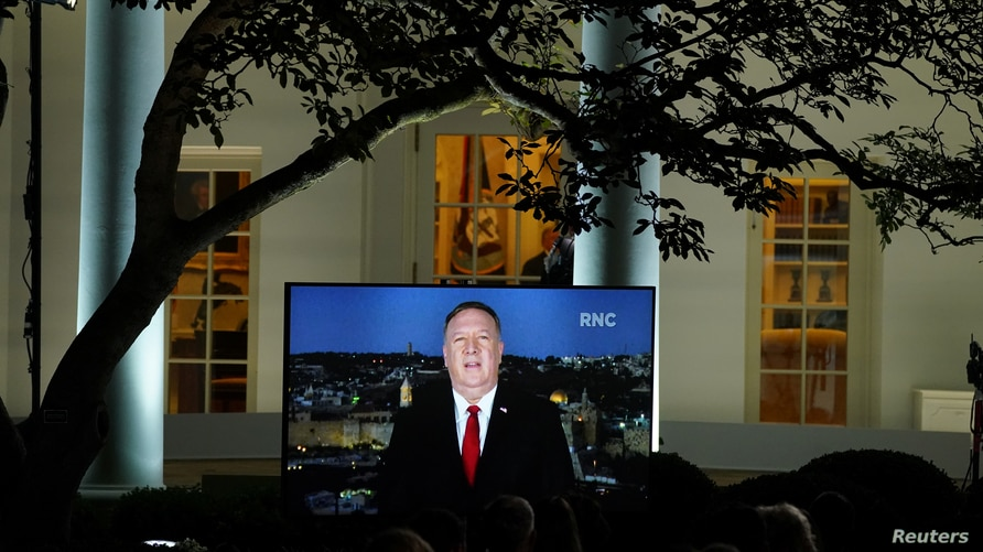 U.S. Secretary of State Mike Pompeo is seen giving his live address to the 2020 Republican National Convention from Israel on a TV at the White House in Washington