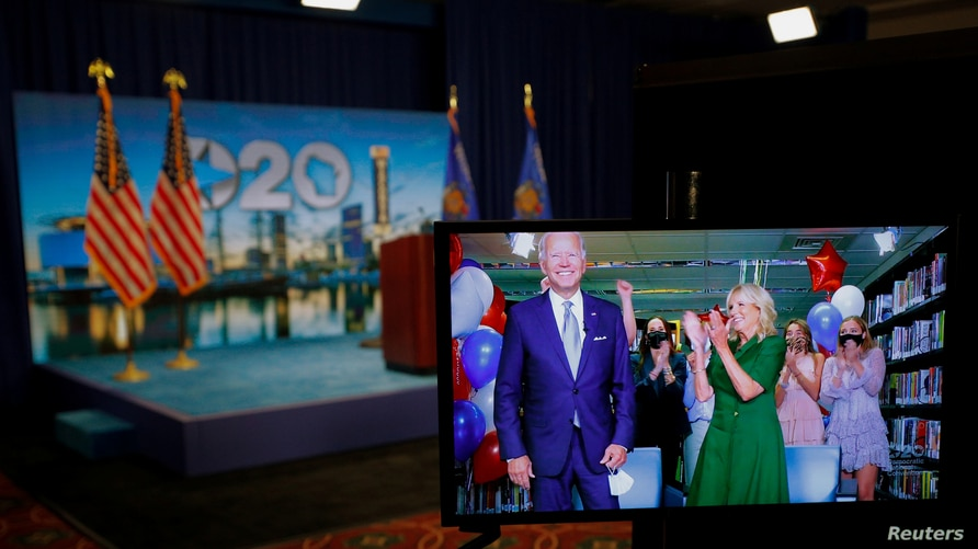 Democratic 2020 presidential nominee and former Vice President Joe Biden is seen in a video feed from Delaware being applauded by his wife Jill and his grandchildren after winning the Democratic Party?s 2020 presidential nomination in Wisconsin