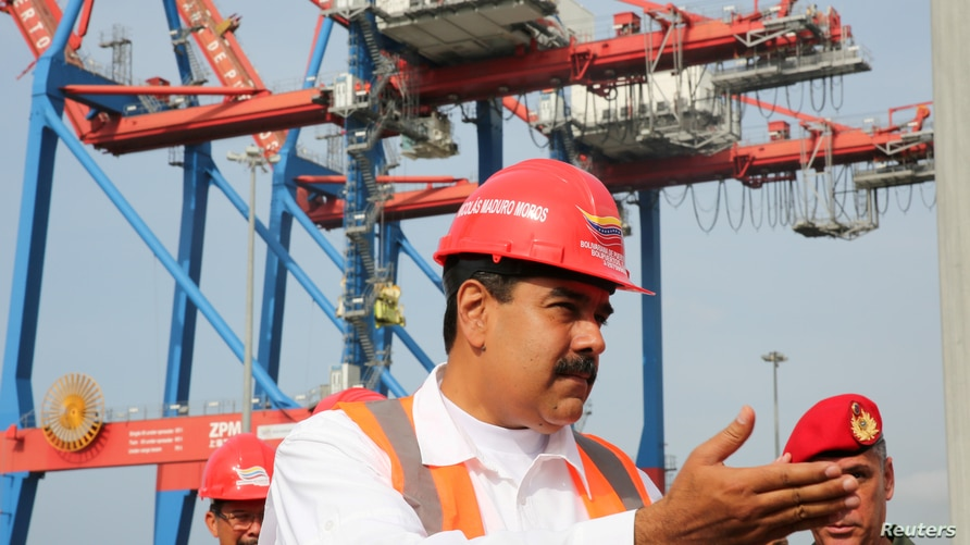 FILE PHOTO: Venezuela's President Nicolas Maduro attends the opening ceremony of a container terminal at the port in La Guaira