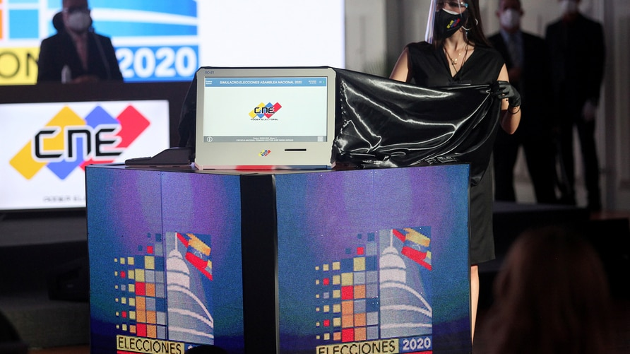 A model shows a voting machine as the Venezuela's National Electoral Council presents the technology platform for the upcoming parliamentary elections in Caracas