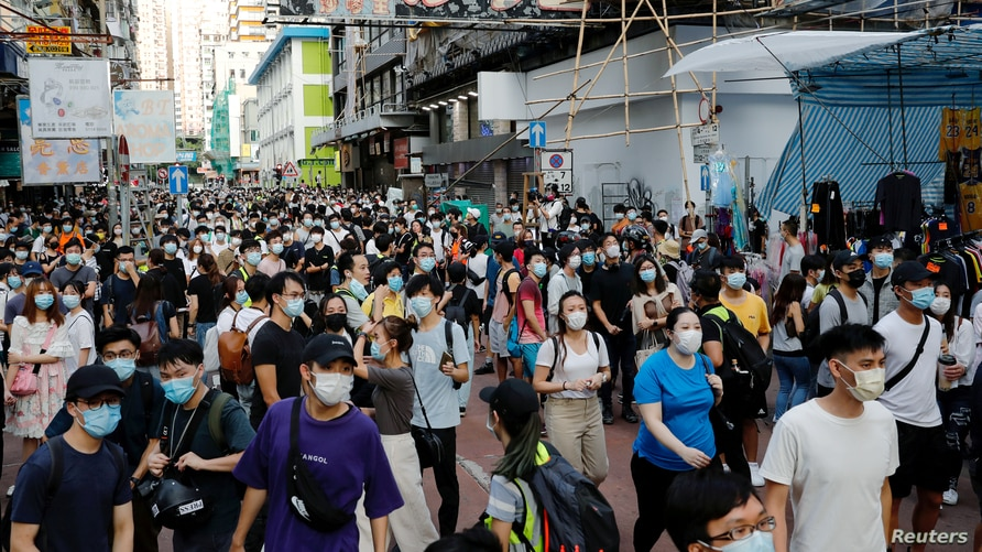 FILE PHOTO: People gather during a demonstration opposing postponed elections, in Hong Kong