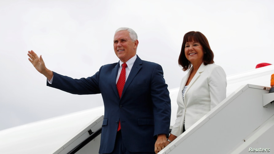 FILE PHOTO: U.S. Vice President Mike Pence and Second Lady Karen Pence leave U.S. Air Force Two as they arrive in Tallinn