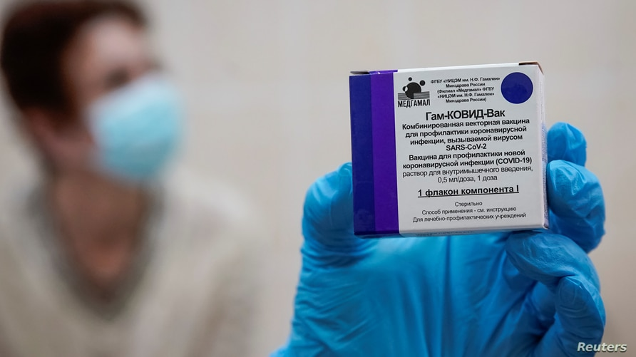 "A nurse shows a box with Russia's ""Sputnik-V"" vaccine against the coronavirus disease (COVID-19) prepared for inoculation in a post-registration trials stage at a clinic in Moscow"