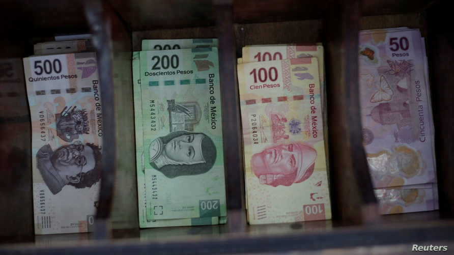 FILE PHOTO: Mexican peso banknotes are pictured at a currency exchange shop in Ciudad Juarez