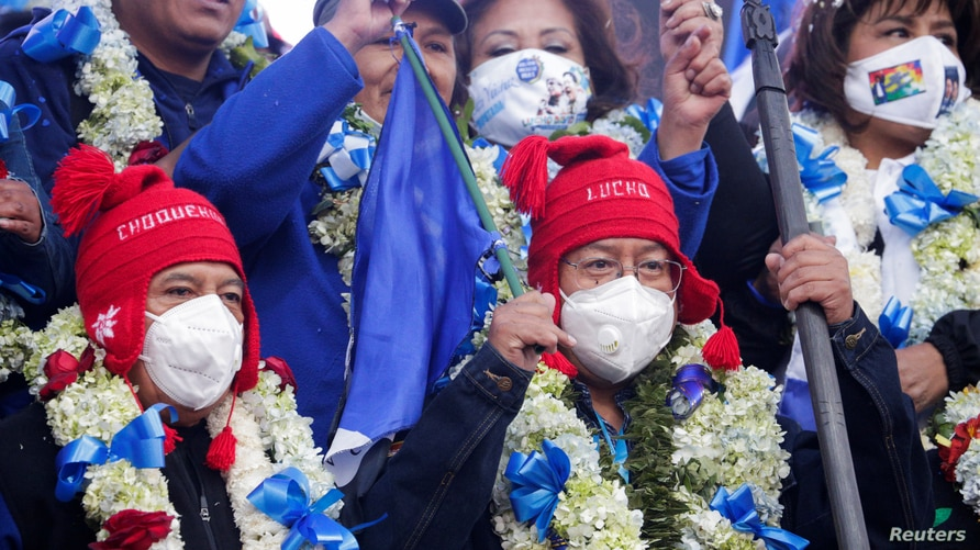 Supporters of the MAS party attend a closing campaign rally in El Alto