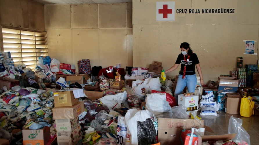 A member of the Nicaraguan Red Cross packs food to be distributed to the victims of Hurricane Iota in Managua