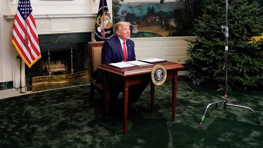 U.S. President Donald Trump  participates in a Thanksgiving video teleconference with members of the military forces at the White House in Washington