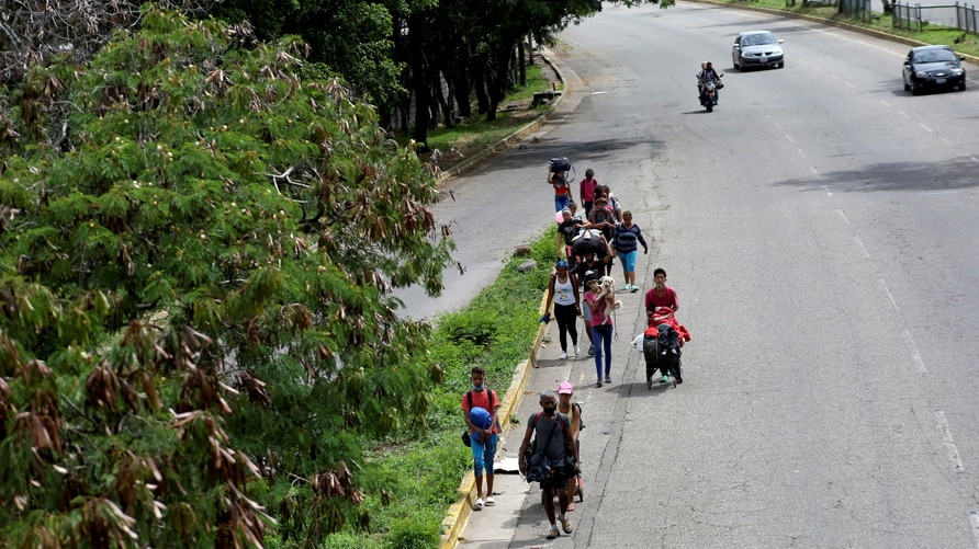 FILE PHOTO: Venezuelan migrants walk towards the border between Venezuela and Colombia during the coronavirus disease (COVID-19) outbreak, in San Cristobal