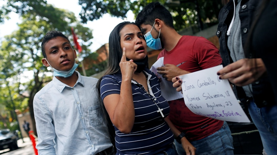 A woman reacts during a protest in front of Trinidad & Tobago embassy, in Caracas