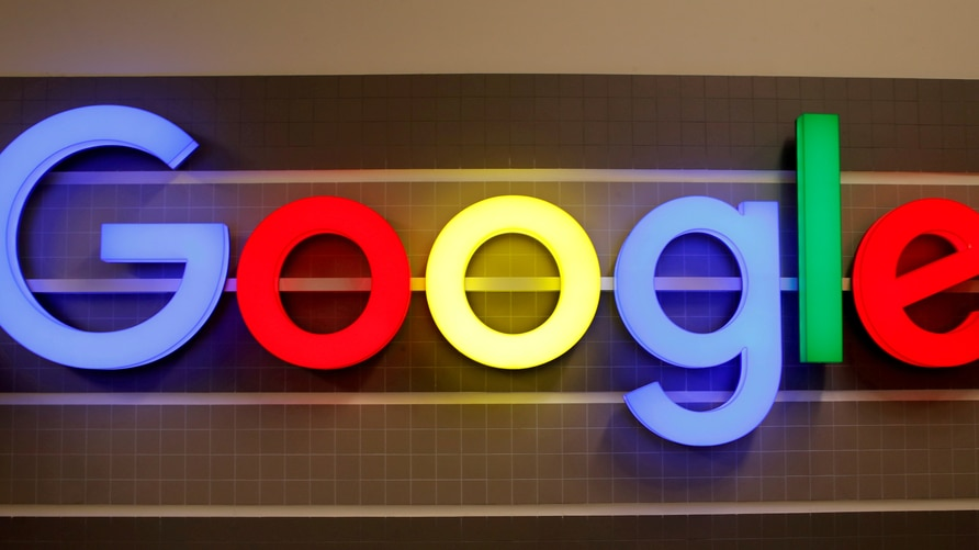 FILE PHOTO: FILE PHOTO: An illuminated Google logo is seen inside an office building in Zurich