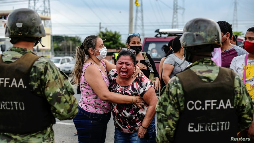 A woman reacts outside a prison where inmates were killed during a riot that the government described as a concerted action by criminal organisations, in Guayaquil