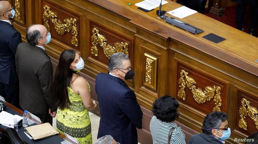 The new directors of Venezuela's National Electoral Council participate in a swearing-in ceremony during an extraordinary session at the National Assembly in Caracas
